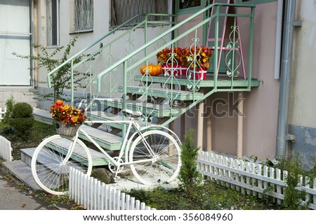 The entrance to the house with baskets of autumn leaves is beautifully issued - stock photo