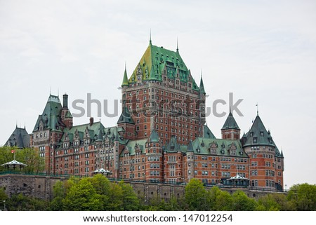 The epic and historic Chateau Frontenac towers over Quebec City. - stock photo