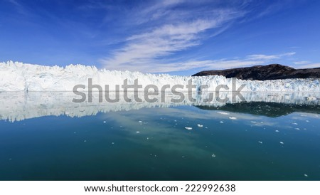 The Eqi Glacier in Greenland - Very few places in Greenland are as beautiful as this glacier 70 km north of Ilulissat in the Disco Bay. The Eqi glacier is one of the most active glaciers in Greenland. - stock photo