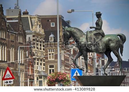 The equestrian statue of Queen Wilhelmina in Amsterdam - stock photo