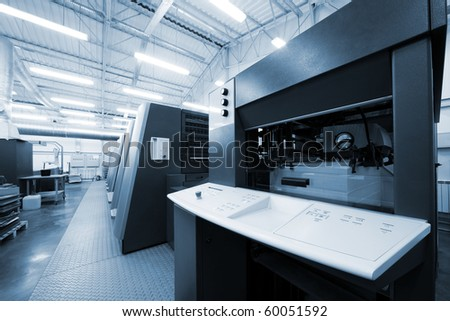 The equipment for printing in a modern printing house - stock photo