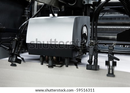 The equipment in a modern printing house - stock photo