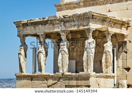 The Erechtheion is an ancient Greek temple on the north side of the Acropolis of Athens in Greece which was dedicated to both Athena and Poseidon. - stock photo