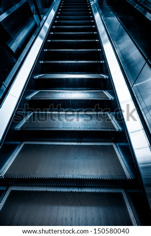 the escalator  of the subway station in shanghai china. - stock photo