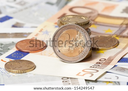 The European currency: banknotes of five and fifty euros and coins
