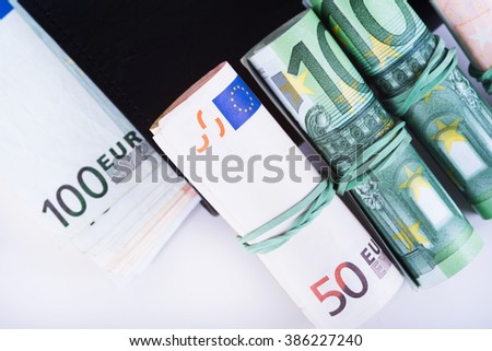 The European currency euro in a black wallet.