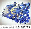 The European Union jigsaw puzzle with Euro symbol points economic crisis - stock photo