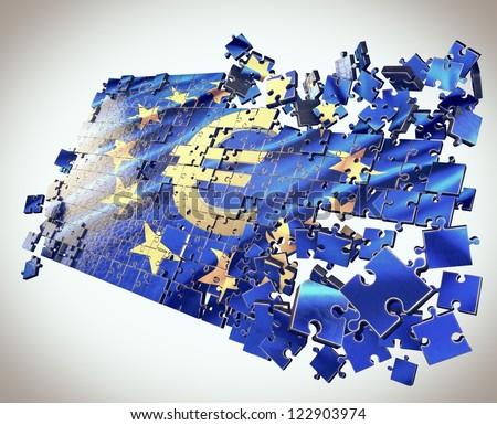 The European Union jigsaw puzzle with Euro symbol points economic crisis - stock photo