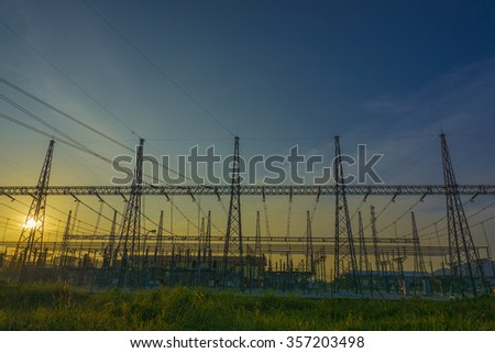 The evening electricity pylon silhouette. Clean energy concept. - stock photo