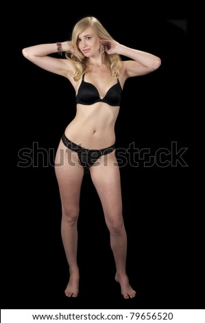 The Evening Wear Striptease Sequence #19: High fashion model in black lingerie. - stock photo