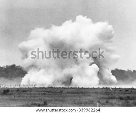 The explosion of Lester P. Barlow's 'GLMITE' bomb at Aberdeen Proving Ground, Maryland. The 1,000 pound liquid oxygen bomb created an powerful roar, but little damage. 84 test goats near the explosion