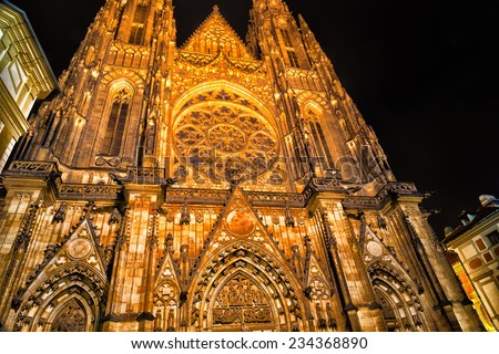 the exterior facade of the cathedral of St Vitus in Prague, a church with dark Gothic towers guarded by gargoyle: this church is the main religious symbol of the Czech Republic - stock photo
