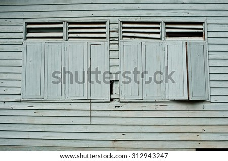 The external wood window and wall of a vintage wood house