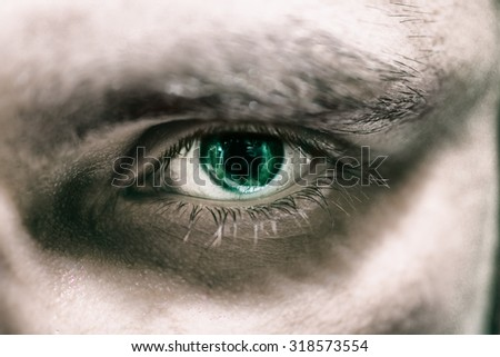 The eye of a young man with green iris macro - stock photo