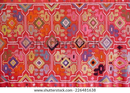 the fabric embroidered with oriental ornaments - background - stock photo