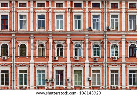 The facade of a house. The old architecture - stock photo