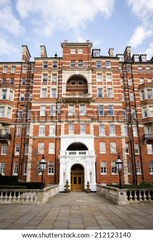The facade of an upmarket apartment block in Kensington, West London. - stock photo