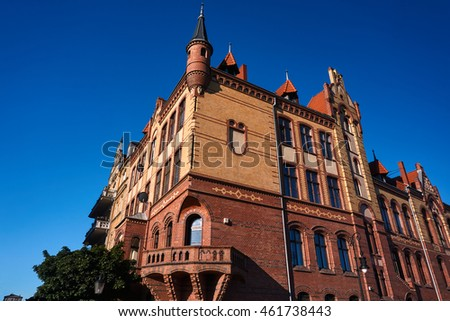 The facade of red brick building in Poznan
