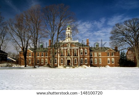 The facade of the Baker Library at Dartmouth College in Hanover NH in winter. Dartmouth is one of the top ten Ivy League colleges in the USA and one of the original Indian Schools. - stock photo