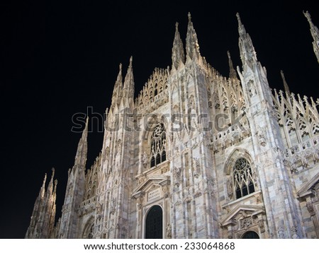 The facade of the gothic cathedral of Milan called the Duomo at night, Italy - stock photo