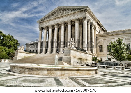 The facade of the Supreme Court of The United States of America in Washington DC. - stock photo