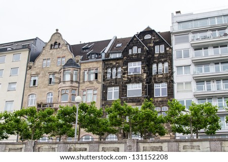 The facades of the quay of Dusseldorf at the sunset - stock photo