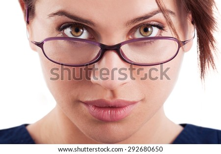 The face of a beautiful and sexy woman wearing glasses, goggles or eyeglasses - stock photo
