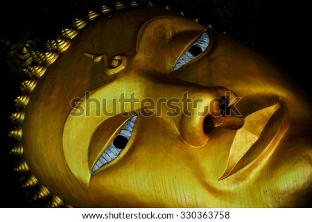 The face of the reclining Buddha - stock photo