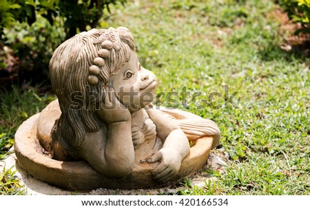 The face of the statue of a mermaid Placed in the park