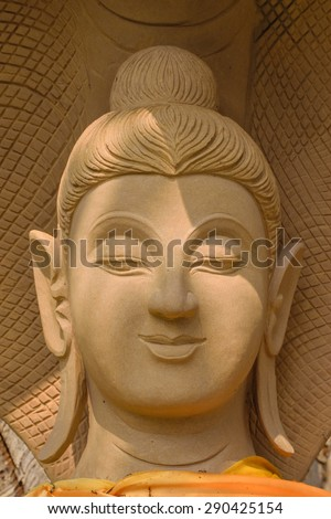 The face statue sandstone of buddha