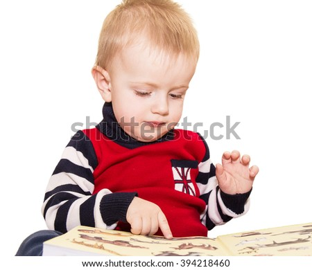 The fair-haired kid considers pictures in the book. It is isolated on a white background - stock photo