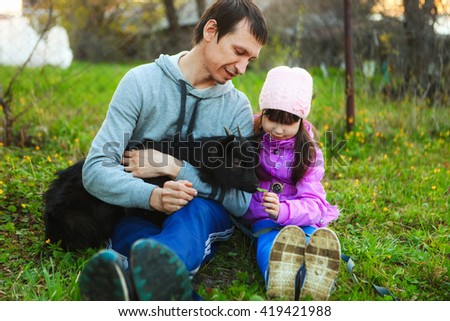 The Family happy outdoor rest a goat. - stock photo