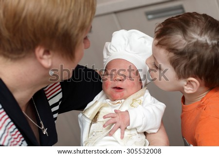 The family looking at newborn at home - stock photo