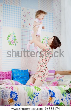 The family, mom throws daughter up - stock photo