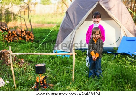 The Family resting in nature with a camping.