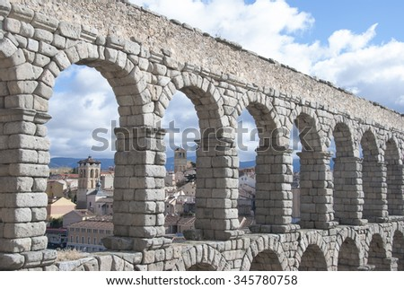 The famous ancient aqueduct in Segovia, Castilla y Leon, Spain.  - stock photo