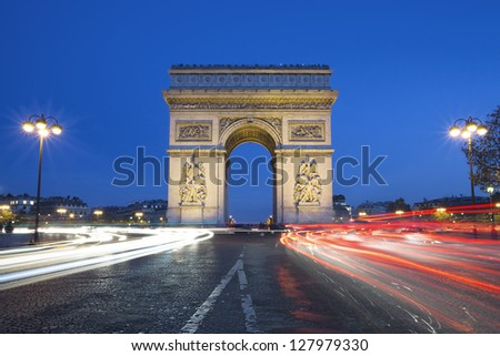 The famous Arc de Triomphe by night, Paris France - stock photo