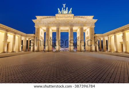 The famous Brandenburger Tor in Berlin is illuminated at night - stock photo