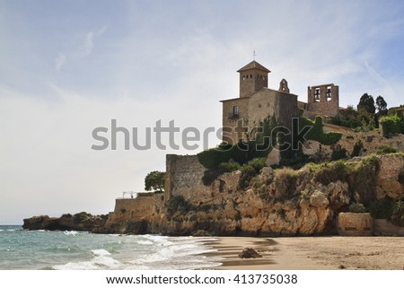 The famous castle of Tamarit an aristocratic house placed over a cliff in the coast of Tarragona, Spain - stock photo