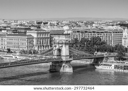 The famous Chain Bridge (1849) is a suspension bridge that spans the River Danube between Buda and Pest. Budapest, Hungary, Europe. Black and white. - stock photo