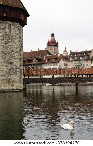 the famous Chapel Bridge and Clock tower background in early winter, Canton of Lucerne, Switzerland - stock photo