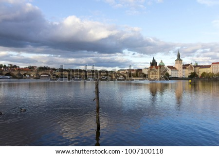 The famous Charles Bridge and the Vltava river in Prague on an autumn afternoon.