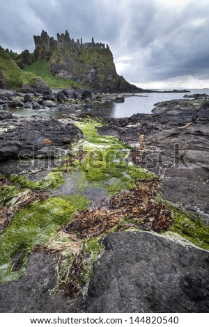 The famous Dunluce castle a unesco landmark from the causeway coast of Northern Ireland - stock photo