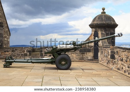 The famous Edinburgh cannon which shoots at one o'clock for correct time keeping at the castle - stock photo