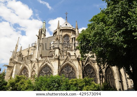 The famous flying buttresses in the rear of the Cathedral of Notre Dame de Paris, France - stock photo
