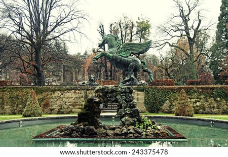 The famous fountain with Pegasus sculpture in Mirabell Gardens in Salzburg, Austria. Toned image - stock photo