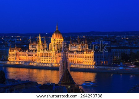 The famous Hungarian Parliament at night with the river Danube.  Budapest, Hungary. - stock photo