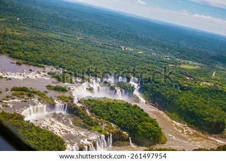The famous Iguazu Falls on the Brazilian-Argentine border. Waterfalls are located in the two national parks - Argentina and Brazil in the dense tropical forests. Picture taken from a helicopter - stock photo