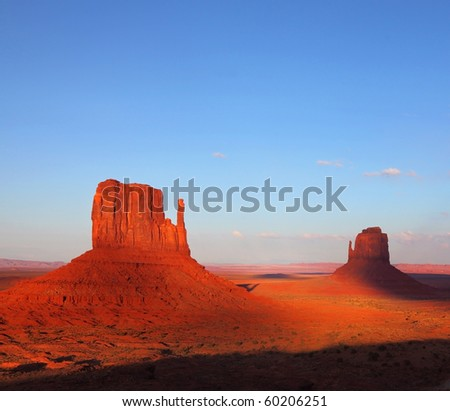 "The famous ""Mittens"" in Monument Valley. The cliffs of red sandstone at sunset - stock photo"