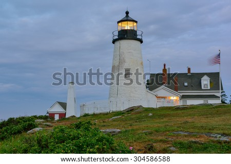 The famous Pemaquid Lighthouse on the Maine Coast in pre-dawn light  - stock photo
